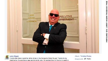 Maryland Gov. Larry Hogan poses outside his office in a Facebook post detailing his treatment for non-Hodgkins lymphoma.