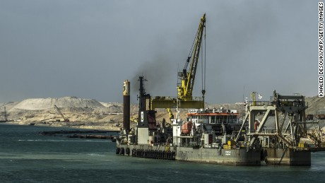 A dredger is seen at work on the new waterway of the Suez canal on June 13, 2015, in the port city of Ismailia, east of the capital Cairo.
