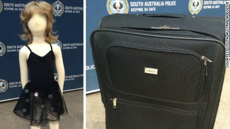 South Australia police display a similar dress and suitcase to ones found near the unidentified girl's body.