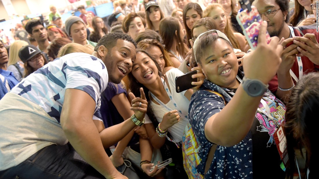 Actor Kel Mitchell takes a selfie with fans Saturday, July 25, at the VidCon event in Anaheim, California.