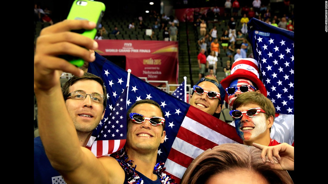 U.S. fans take a photo together on Saturday, July 25, as they attend the Volleyball World Grand Prix in Omaha, Nebraska.