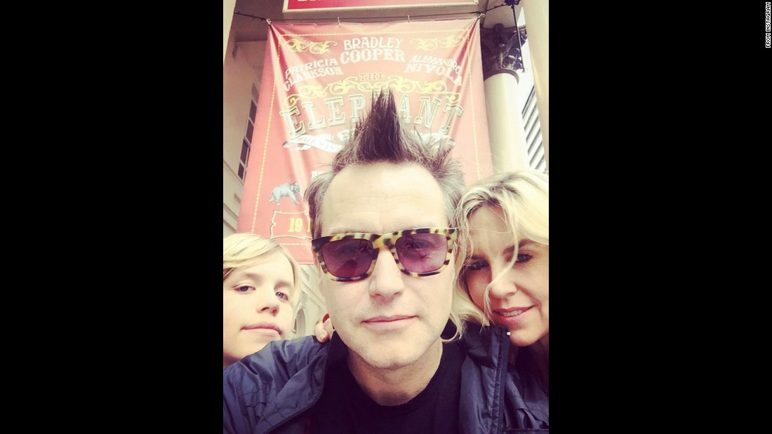 "Mark Hoppus, from the band Blink-182, takes a selfie with his wife and son after they saw a play in London on Monday, July 27. ""Checked out my BFF Bradley Cooper tonight portraying John Merrick in The Elephant Man,"" <a href=""https://instagram.com/p/5p46rYtaTQ/"" target=""_blank"">Hoppus said on Instagram.</a>"