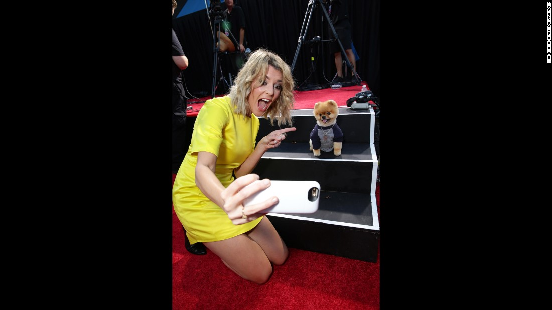 "Comedian Grace Helbig takes a selfie with Jiff, <a href=""http://www.guinnessworldrecords.com/news/2014/8/video-introducing-jiff-the-fastest-dog-on-two-paws-59860/"" target=""_blank"">the fastest dog on two paws</a>, at the Los Angeles premiere of ""Smosh: The Movie"" on Wednesday, July 22."