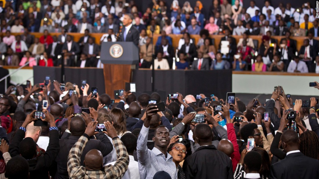 "While U.S. President Barack Obama speaks in Nairobi, Kenya, an audience member takes a selfie on Sunday, July 26. <a href=""http://www.cnn.com/2015/07/25/world/gallery/obama-kenya-ethiopia/index.html"" target=""_blank"">See more photos of Obama's trip to Kenya and Ethiopia</a>"
