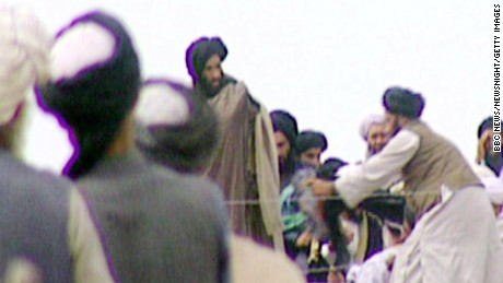 In this image taken off television by BBC Newsnight shows Taliban's one-eyed spiritual leader Mullah Mohammed Omar, center, during a rally with his troops in Kandahar before their victorious assault on Kabul in 1996.