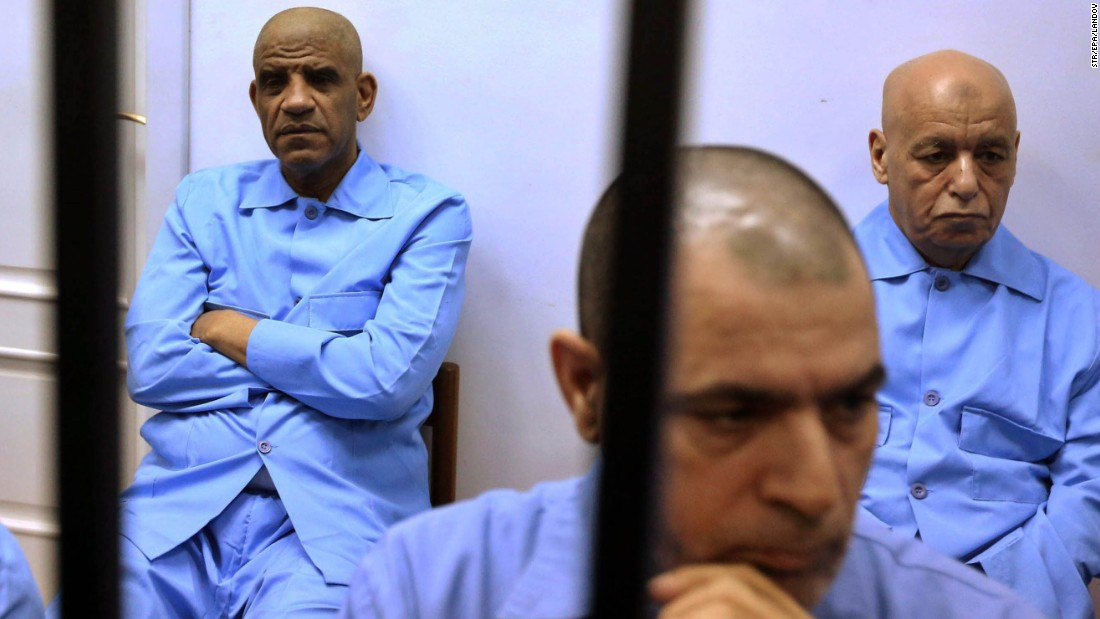 "Former Libyan spy chief Abdullah al-Senussi, left, attends his trial in Tripoli, Libya, on Tuesday, July 28. A Libyan court <a href=""http://www.cnn.com/2015/07/28/africa/libya-saif-al-islam-gadhafi-sentence/"" target=""_blank"">handed out death sentences</a> to al-Senussi and several other officials from the former regime of Moammar Gadhafi."