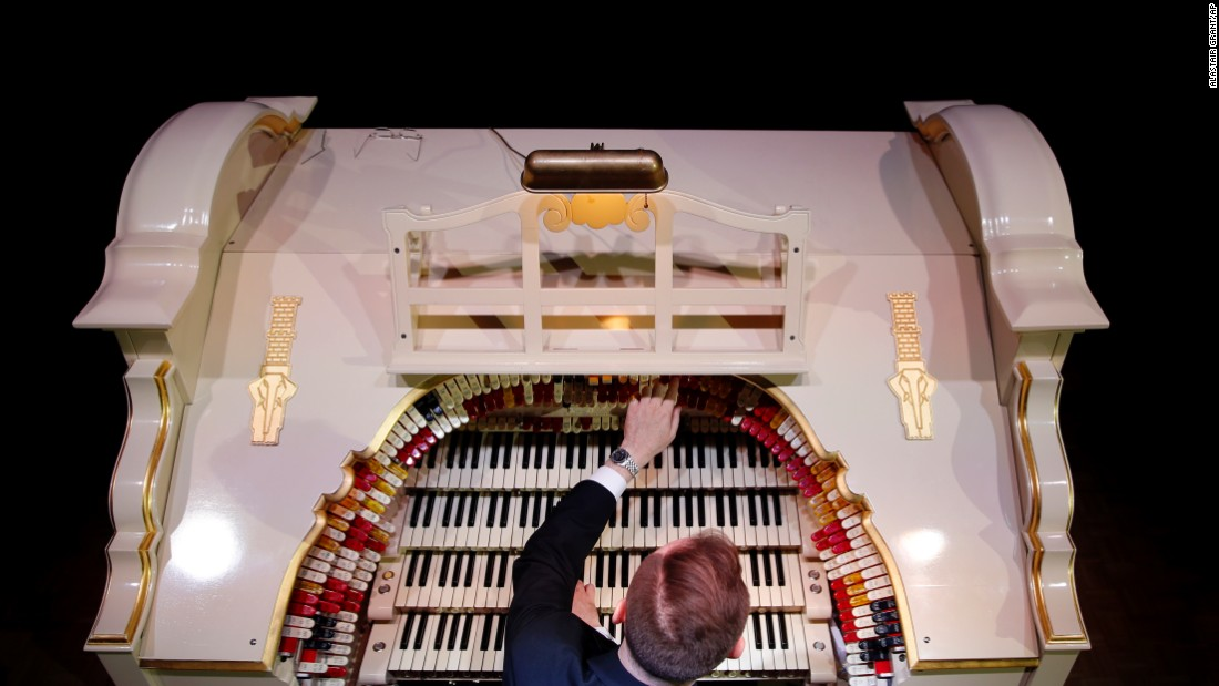 Richard Hill plays a newly restored Wurlitzer Theatre Pipe Organ, believed to be the largest in Europe, at the Troxy entertainment venue in London on Wednesday, July 29. The Wurlitzer has more than 1,728 pipes to go with four keyboards, one pedal board and 241 stop keys.