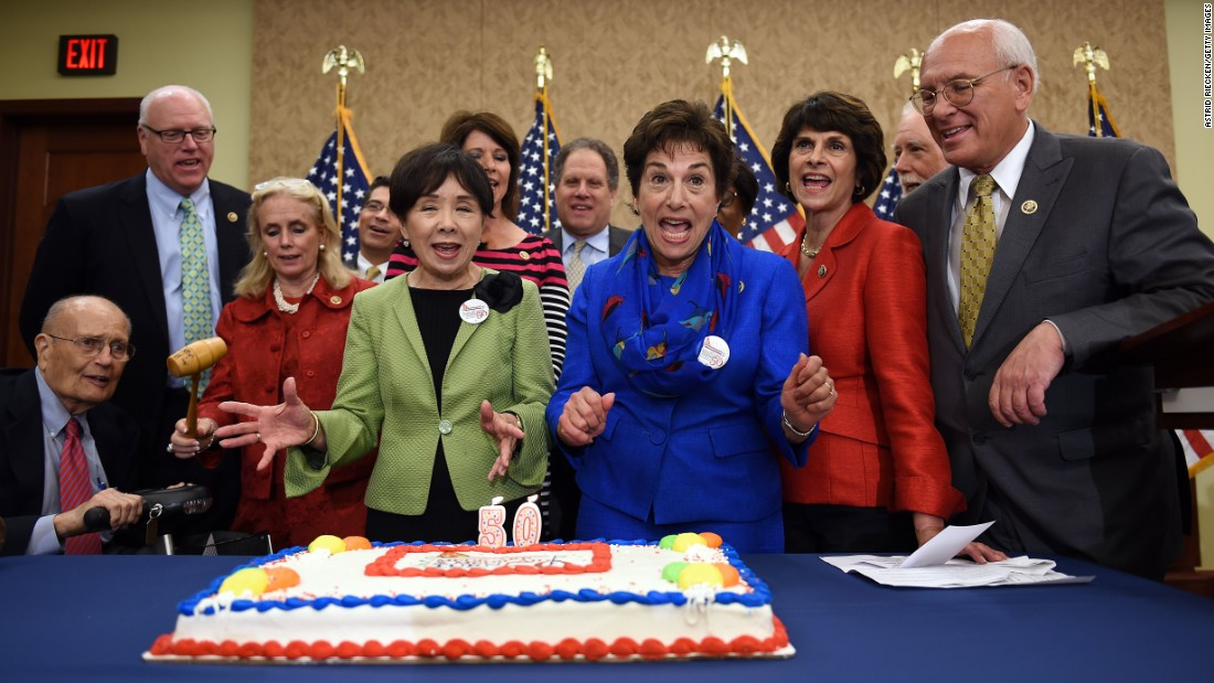 Current and former members of the U.S. Congress celebrate the 50th anniversary of Medicare and Medicaid with a special cake Wednesday, July 29, in Washington. During the event on Capitol Hill, they promised they would fight any proposed cuts to the programs.