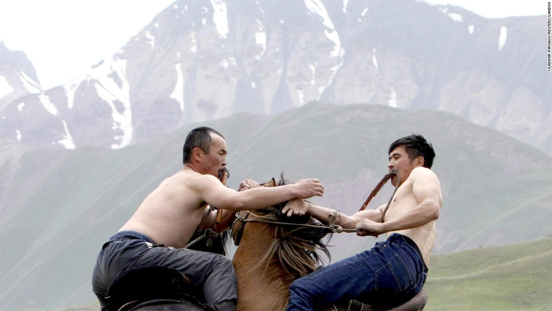 During Kyrgyzstan's national horse games, two men wrestle while riding horses on Saturday, July 25.