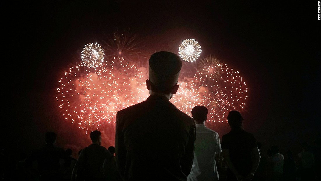 "A soldier watches fireworks explode in Pyongyang, North Korea, on Monday, July 27. The country was celebrating the 62nd anniversary of the armistice that ended the Korean War. <a href=""http://www.cnn.com/2015/07/24/world/gallery/week-in-photos-0724/index.html"" target=""_blank"">See last week in 38 photos</a>"