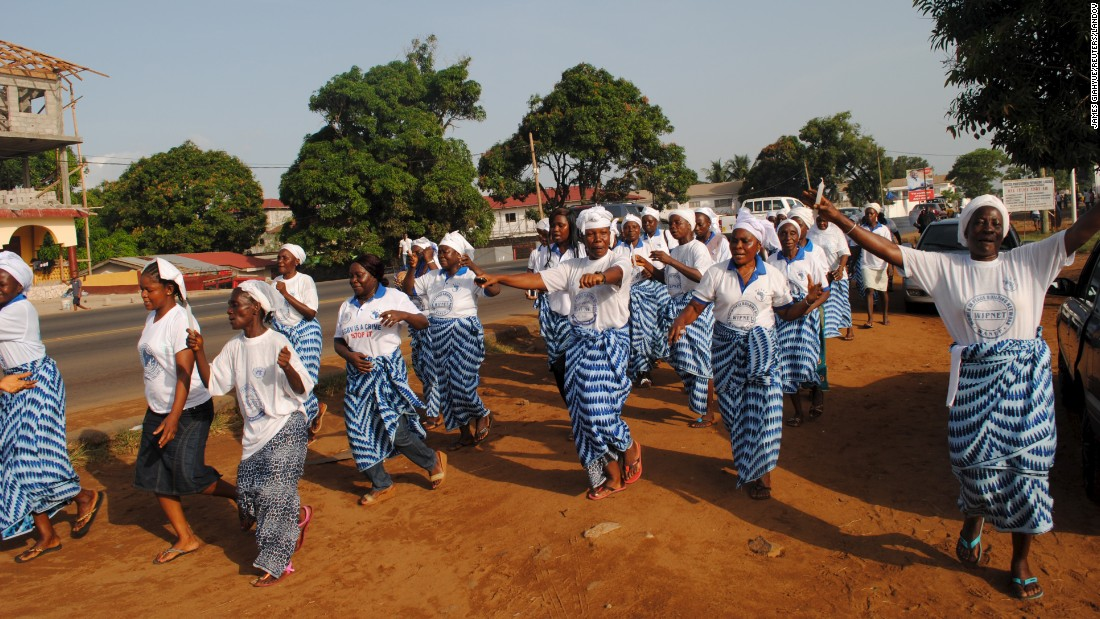 Women in Monrovia celebrate after the World Health Organization declared Liberia Ebola-free on May 9. Other cases have recurred since, however. Two people in Liberia have died of the disease since the end of June, just weeks after the WHO declared the nation free of the disease.