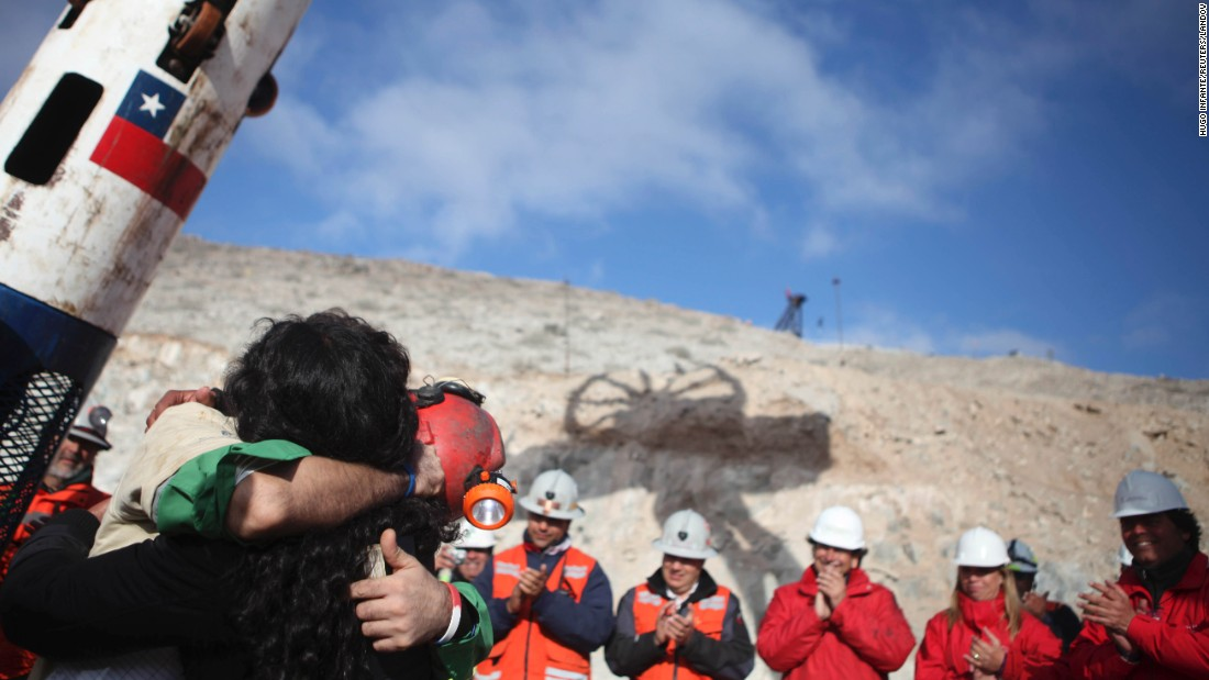 Miner Alex Vega hugs his wife after his rescue on October 13. All 33 miners were rescued.