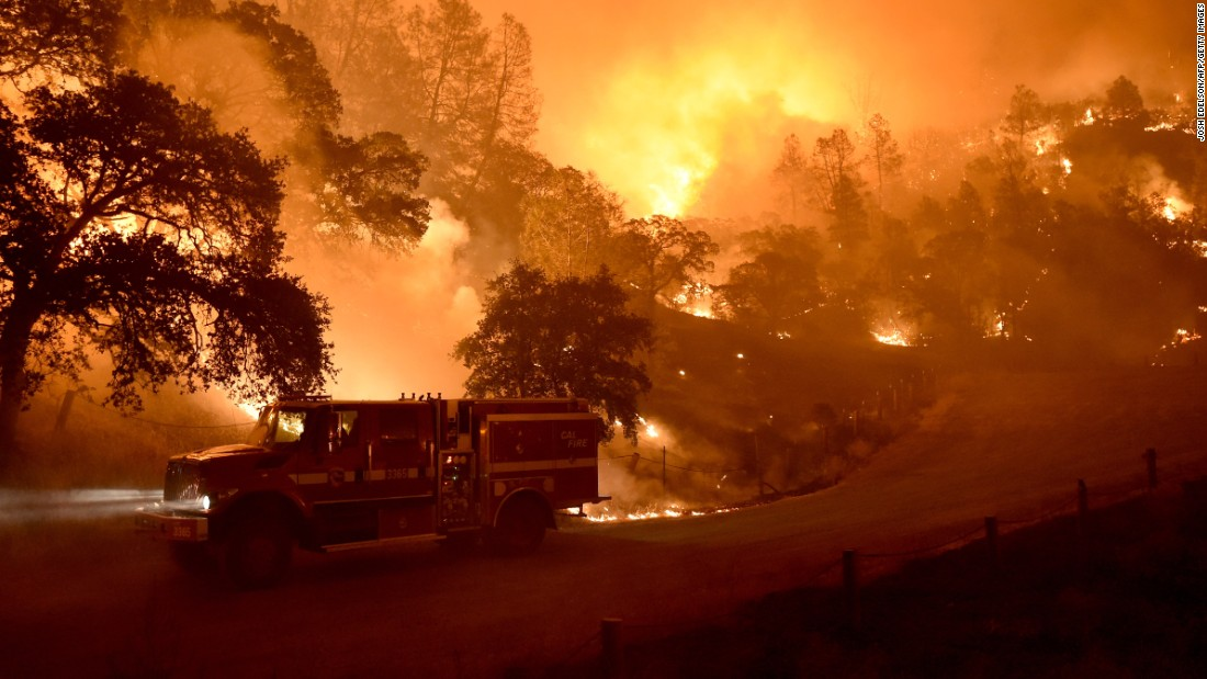California wildfires: Thousands evacuated as flames spread ...