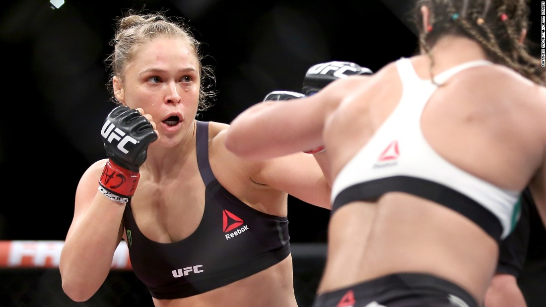 "UFC fighter Ronda Rousey (left) has endorsed Bernie Sanders. ""I'm voting for Bernie Sanders, because he doesn't take any corporate money,"" Rousey told Maxim. As for Trump? ""I wouldn't vote for him,"" she told CNN. ""I don't want a reality TV star to be running my country."""