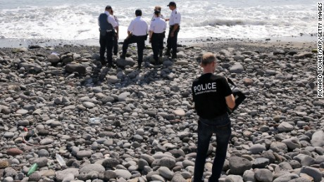 Police officers inspect metallic debris found on a beach in Saint-Denis on the French Reunion Island in the Indian Ocean on August 2, 2015, close to where where a Boeing 777 wing part believed to belong to missing flight MH370 washed up last week. A piece of metal was found on La Reunion island, where a Boeing 777 wing part believed to belong to missing flight MH370 washed up last week, said a source close to the investigation. Investigators on the Indian Ocean island took the debris into evidence as part of their probe into the fate of Malaysia Airlines flight MH370, however nothing indicated the piece of metal came from an airplane, the source said. AFP PHOTO / RICHARD BOUHETRICHARD BOUHET/AFP/Getty Images