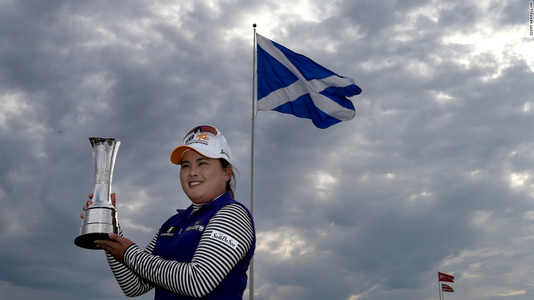 The world's top-ranked women's golfer, Inbee Park, poses with her trophy after winning the Women's British Open in Turnberry, Scotland, on Sunday, August 2. It is her seventh major title.