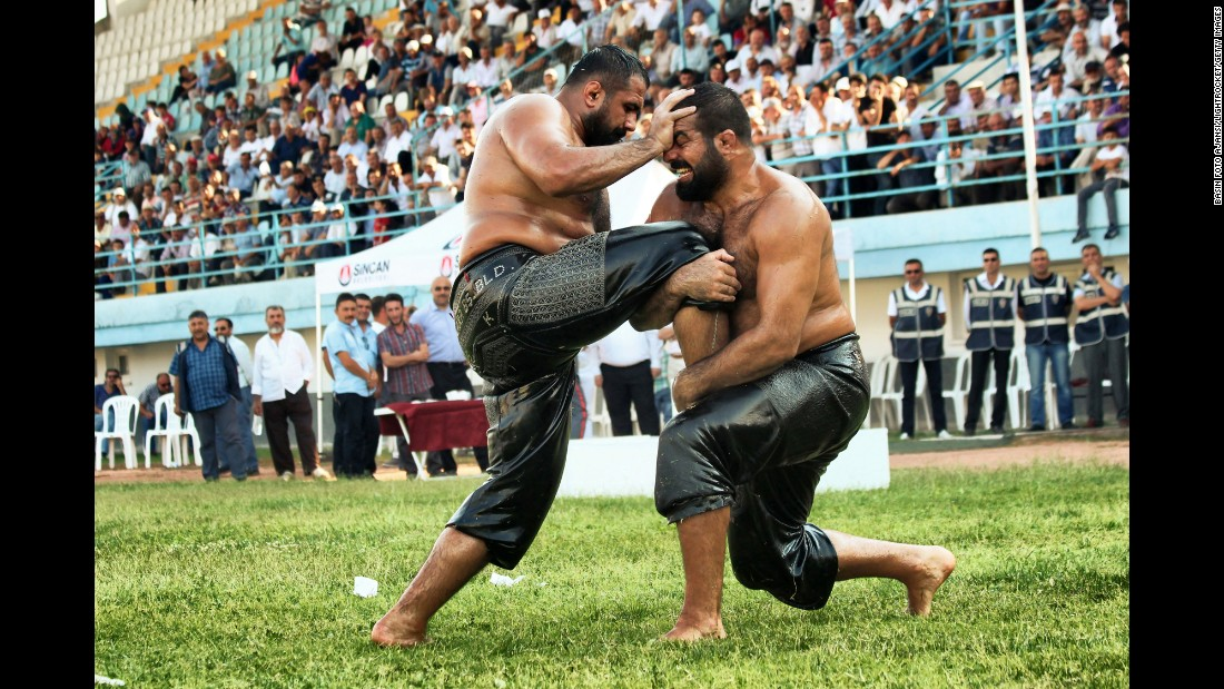 Two men in Ankara, Turkey, compete in an oil-wrestling tournament on Saturday, August 1.