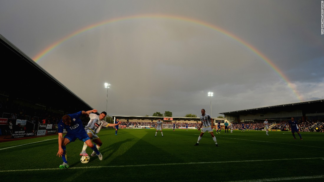 A rainbow appears over the Pirelli Stadium in Burton upon Trent, England, during a preseason soccer match between Burton Albion and Leicester City on Tuesday, July 28.