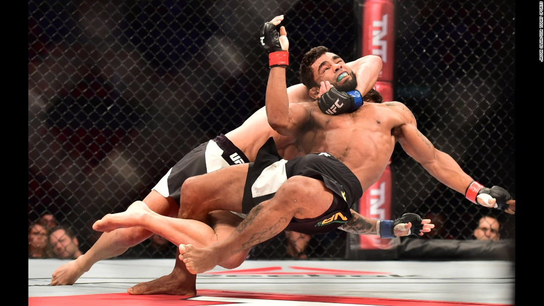 Hugo Viana is brought down by Guido Cannetti during their UFC bout in Rio de Janeiro on Saturday, August 1. Cannetti won by unanimous decision.