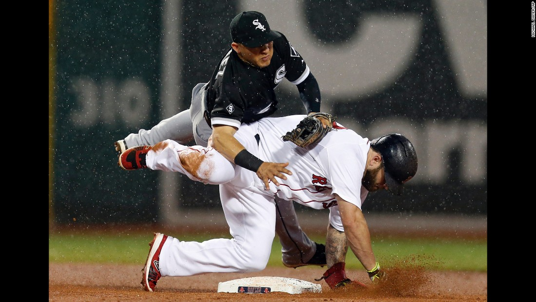 Chicago White Sox infielder Carlos Sanchez falls over Boston's Mike Napoli after a force-out play on Thursday, July 30.