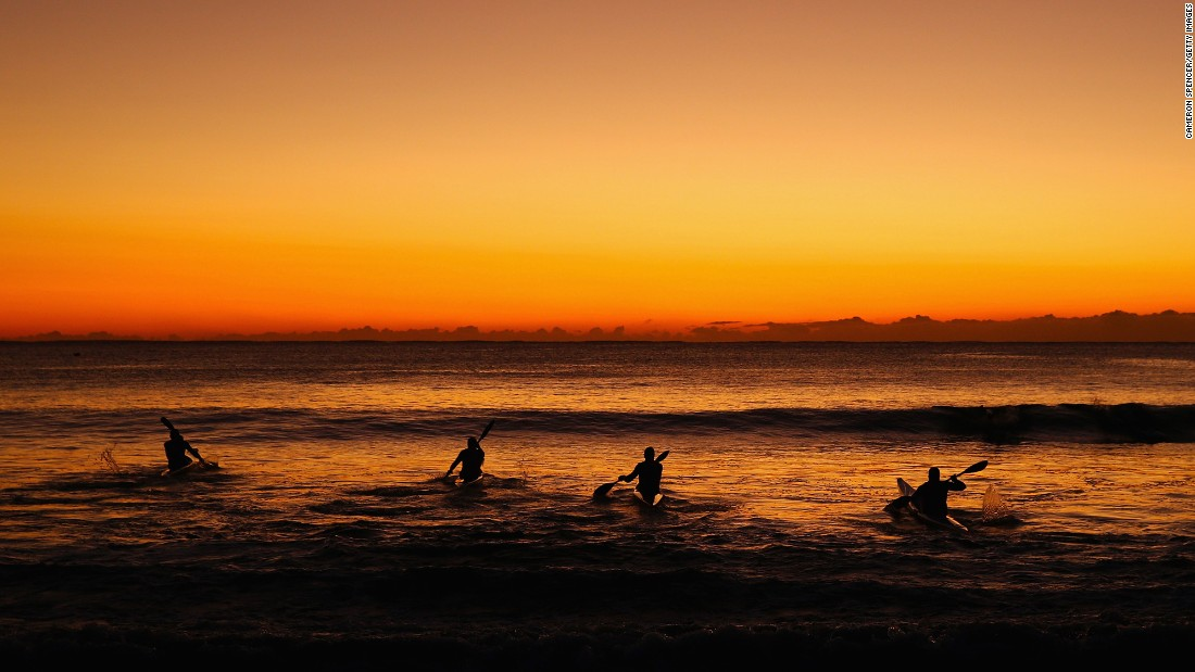 Kayakers train at Sydney's Manly Beach on Tuesday, July 28.