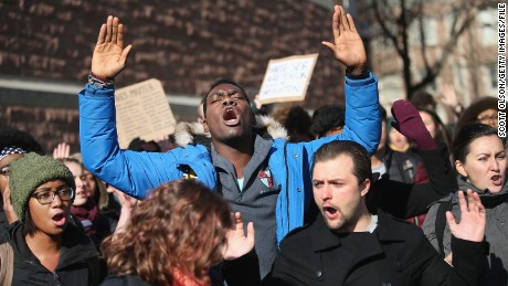 People at Washington University in St. Louis protest last December to draw attention to police abuse.