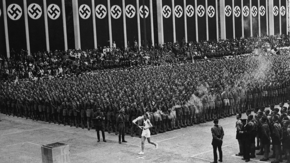 "These Games will forever be associated with Adolf Hitler and his brutal regime. Germany's Fuhrer viewed it as an ideal opportunity<a href=""/2015/07/31/sport/germany-berlin-jewish-olympics-maccabi/index.html"" target=""_blank""> to show the supremacy of the Aryan race</a>, but American Jesse Owens flew in the face of such prejudices by winning four gold medals -- three in sprint events and one in the long jump. The first torch relay was held, with the flame carried from Mount Olympus to the Olympic Stadium."