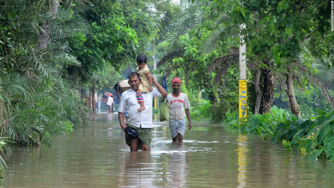 Indian villagers wade through floodwater in Bherampur Block, Murshidabad. In Gujarat, India's westernmost state, 71 people have died. Another 69 have died in West Bengal and 38 have lost their lives in Rajasthan, according to State Home Ministry Spokesman Kuldeep Dhatwalia.