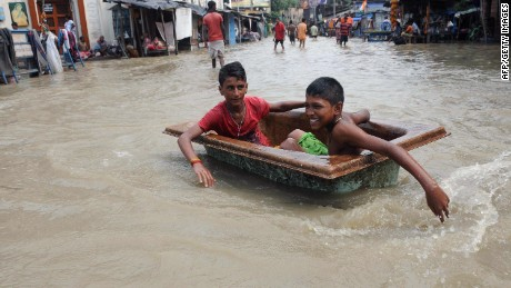 Indian children play on a flooded street in Kolkata on August 3, 2015. Parts of the eastern city were flooded as the river Ganges burst its banks following heavy monsoon rains. AFP PHOTOSTR/AFP/Getty Images