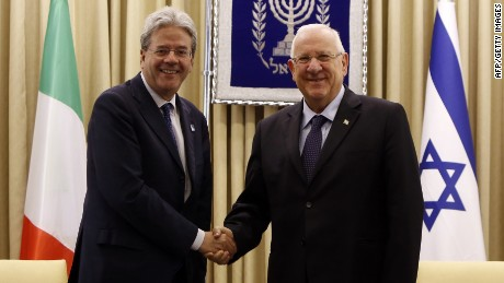 Israeli President Reuven Rivlin (R) greets Italian Foreign Affairs minister Paolo Gentiloni at the presidential compound in Jerusalem on June 30, 2015. AFP PHOTO / GALI TIBBONGALI TIBBON/AFP/Getty Images