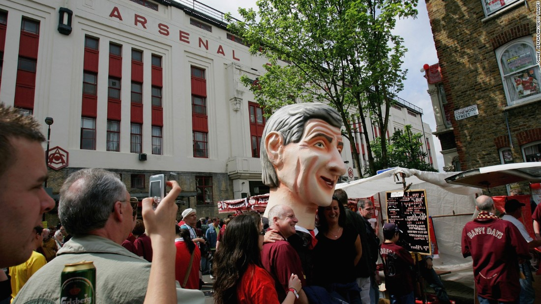 Arsenal fans carry an over-sized replica of Arsene Wenger as they attend the club's final game at Highbury on 7 May 2006. The Gunners beat Wigan 4-2 as Thierry Henry hit a hat-trick.