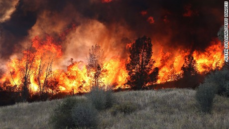 Firefighters used a backfire to try to head off the Rocky Fire on Monday near Clearlake, California.