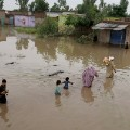 Flooding pakistan family crossing