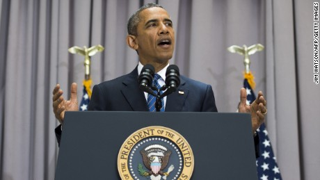 "US President Barack Obama delivers remarks on the nuclear deal reached with Iran at American University in Washington, DC, August 5, 2015.  In 1963 US President John F. Kennedy traveled the short distance from the White House to American University to muster support for diplomatic engagement with nuclear foe the Soviet Union. On Wednesday, at the same spot, President Obama will echo Kennedy's entreaty, arguing for a nuclear deal with Iran -- a country described by his predecessor as part of an ""axis of evil."""