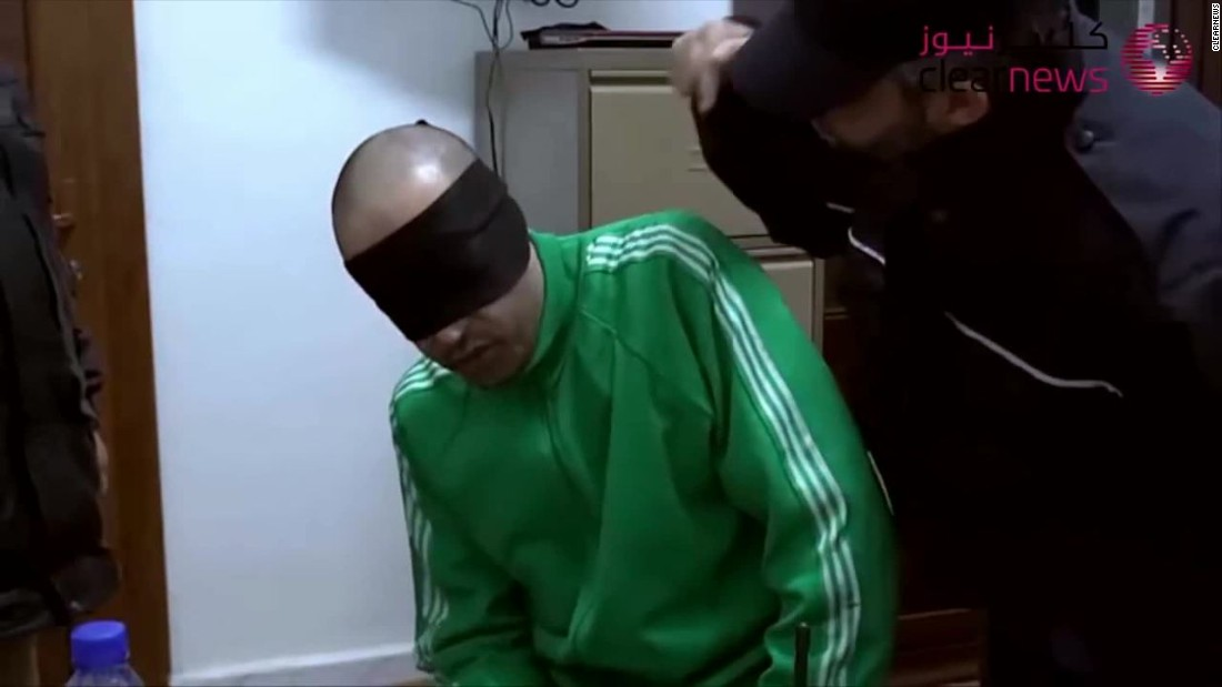 Video shows Moammar Gadhafi's son, blindfolded and being insulted, beaten