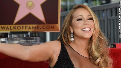 Singer Mariah Carey is honored with the 2,556th star on The Hollywood Walk of Fame in Hollywood, California on August 5, 2015.  Mariah Carey is the best-selling female artist of all time with more than 200-million albums sold so far and 18 Billboard Hot 100 No. 1 singles.                 AFP PHOTO/MARK RALSTON        (Photo credit should read MARK RALSTON/AFP/Getty Images)