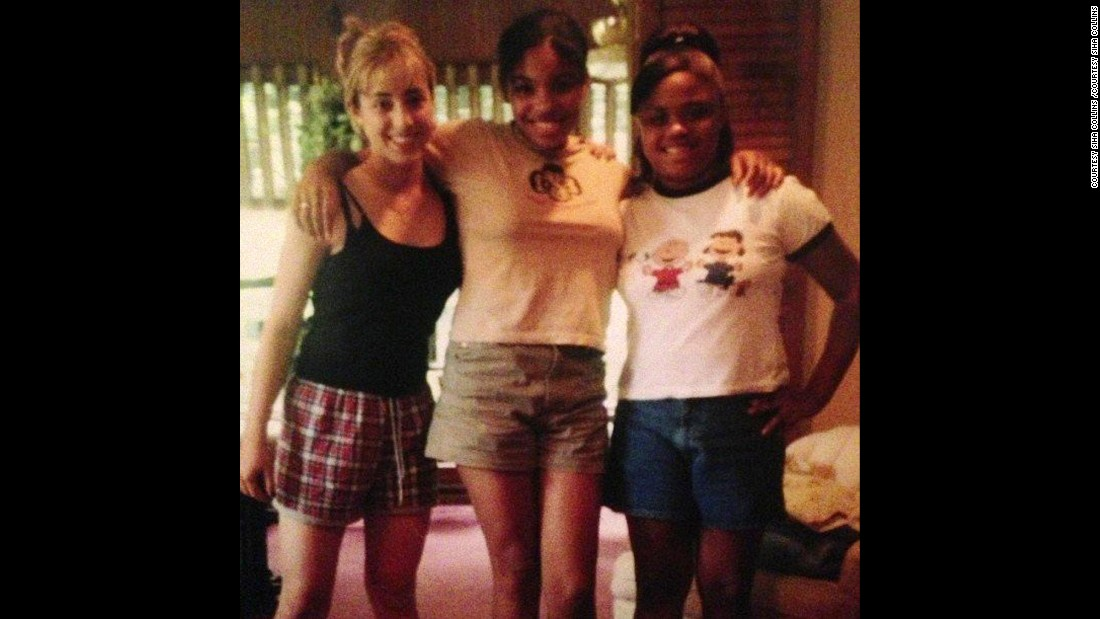 Siha Collins (middle) is pictured here in 1996 in the sixth grade. She was already taller and more developed than her friends.
