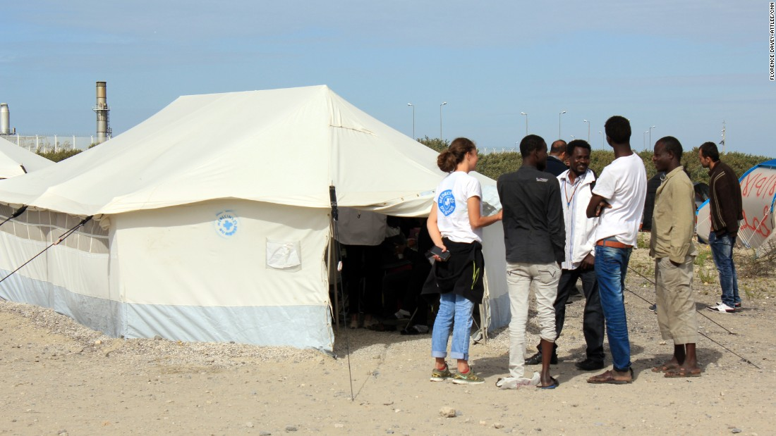The hospital tent is run by Medecins du Monde. They see many broken arms and legs, as well as cuts and scrapes after people have tried to climb into trucks and over fences. They are also seeing scabies and respiratory infections from the living conditions in the camp and the dust.