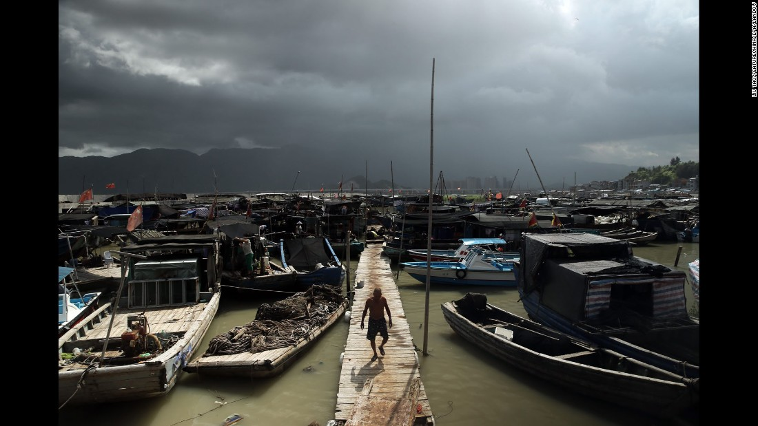 A fisherman walks on a pier in Ningde, China, on Friday, August 7.