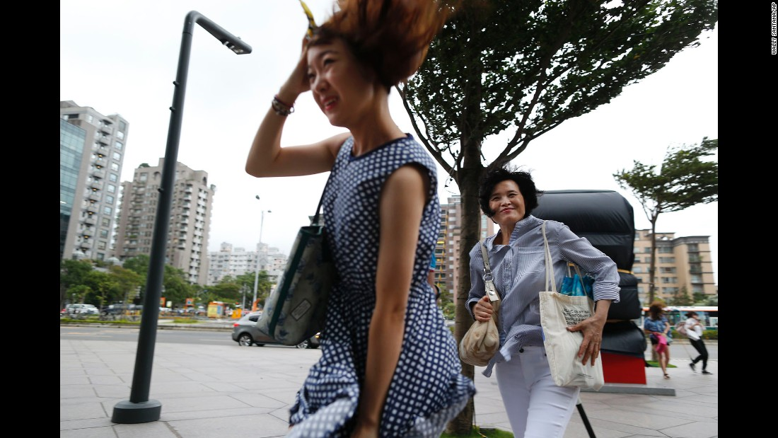 Two women battle the winds from the approaching typhoon in Taipei, Taiwan, on August 7.