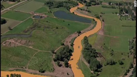 River turns orange after waste contamination
