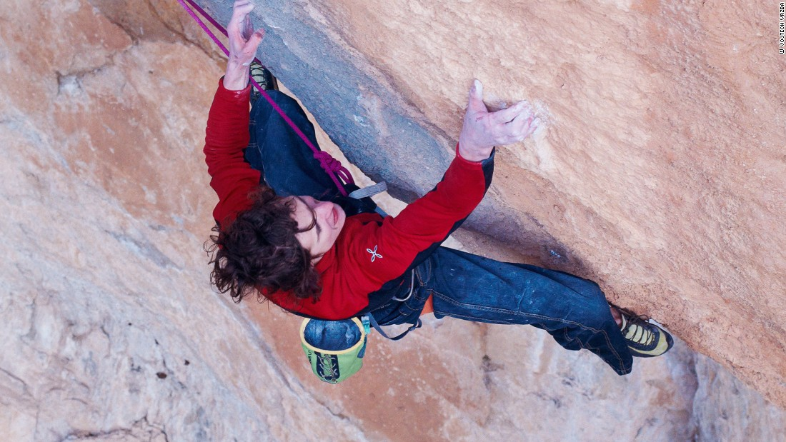 "Ondra negotiating a rock face in Spain. ""I think the most important thing is to have the passion for climbing because you don't make a huge amount of money,"" he says. Unless you really have fun while doing climbing there's not enough motivation to keep pushing hard and living this lifestyle."""