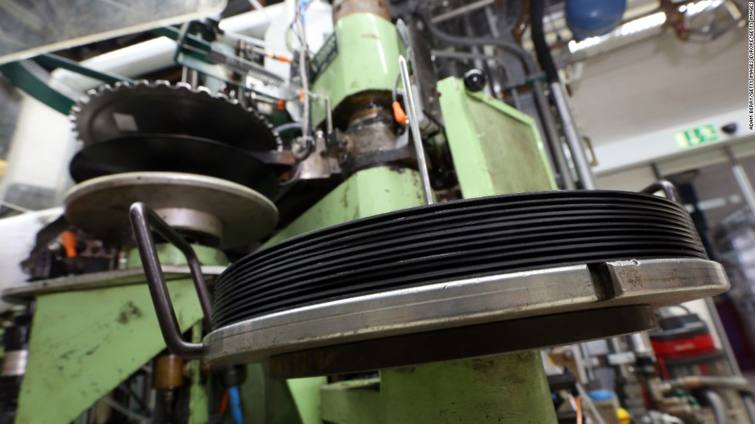 A machine presses vinyl albums at the Optimal record plant in Roebel, Germany.  The vinyl industry is operating above capacity with old equipment performing heavy workloads.