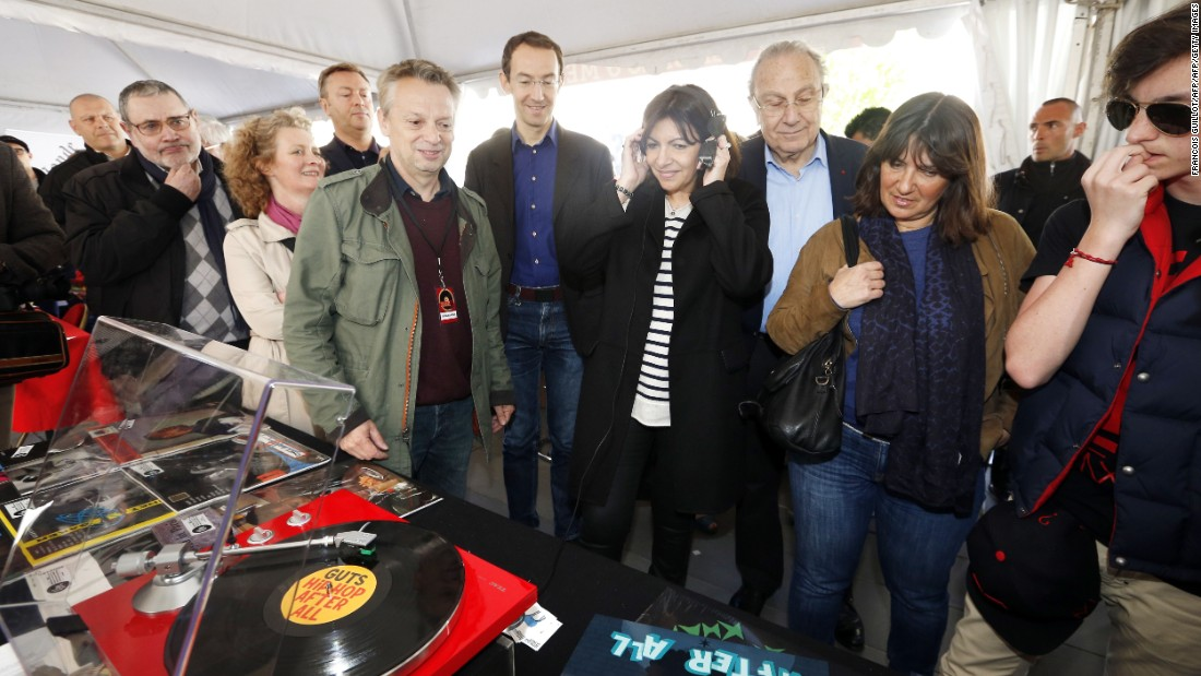"Global vinyl sales rose 54% in 2014, partly driven by the introduction of ""Record store day"" around the world. The Mayor of Paris Anne Hidalgo attended her city's event in 2015."