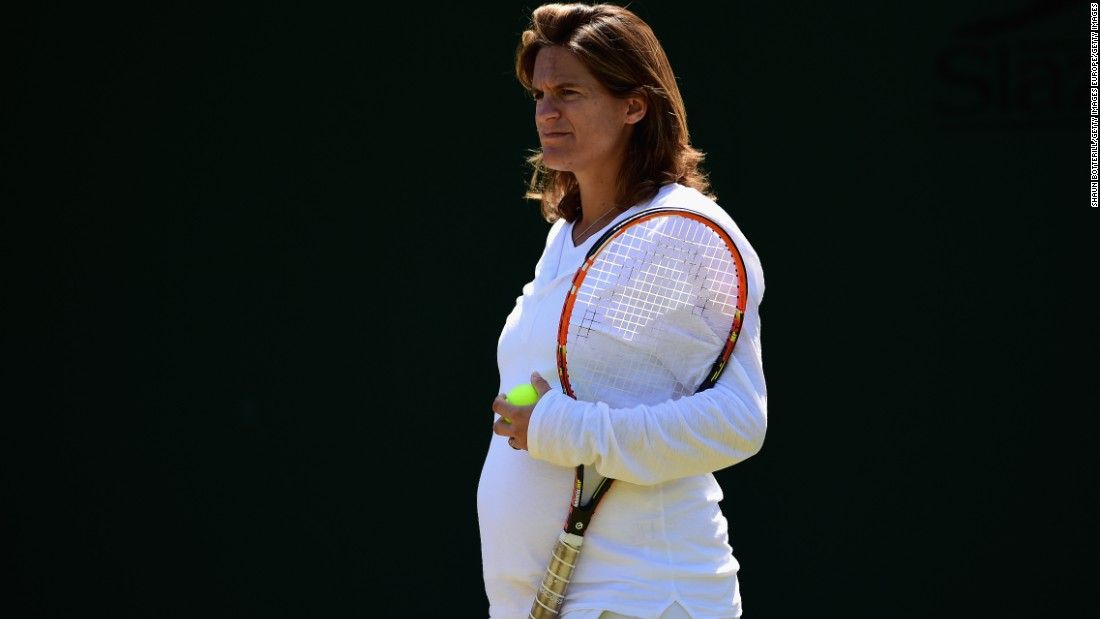 Heavily pregnant Coach Amelie Mauresmo looks on during a Wimbledon practice session for Andy Murray in July. Mauresmo is the first female to coach a top player on the men's tour.