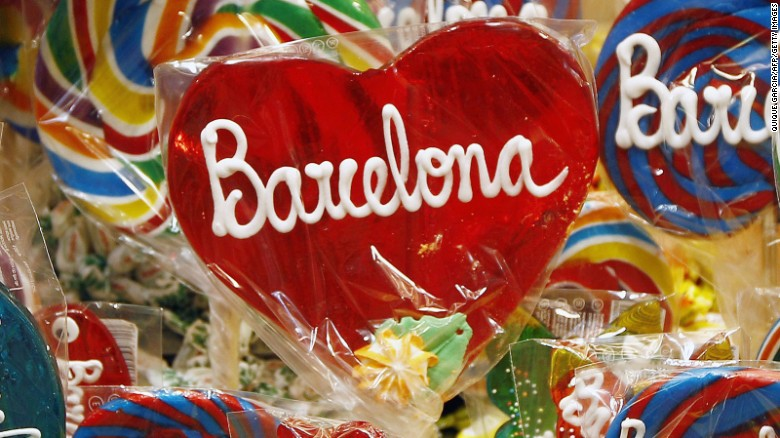 Lollipops with the name of Baecelona on them are displayed for sale at 'La Boqueria' green market in Barcelona on June 29, 2015. Tourists generated 14% of municipal GDP, but these 27 million visitors in Barcelona are a headache for the new mayor Ada Colau , who wants to prevent this Mediterranean port from becoming a theme park. AFP PHOTO / QUIQUE GARCIA TO GO WITH AN AFP STORY BY DANIEL BOSQUE (Photo credit should read QUIQUE GARCIA/AFP/Getty Images)