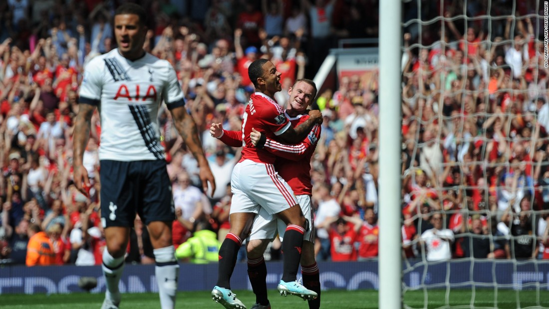 Manchester United's Dutch midfielder Memphis Depay (2nd R) celebrates with Wayne Rooney (R) after United take the lead due to an own goal from Tottenham Hotspur defender Kyle Walker during the English Premier League football match between Manchester United and Tottenham Hotspur at Old Trafford in Manchester.