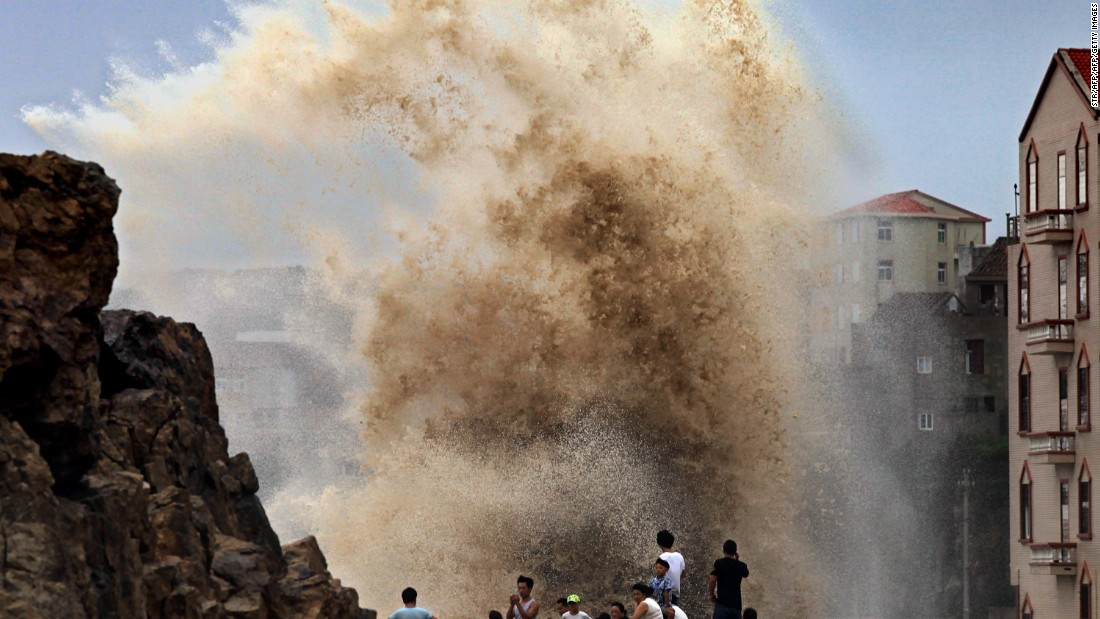 Residents gather to see huge waves stirred up by Typhoon Soudelor in Wenling, China, as the storm draws near the mainland on August 8.