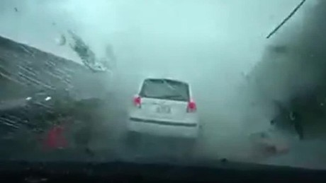 Watch Typhoon Soudelor blow this car away