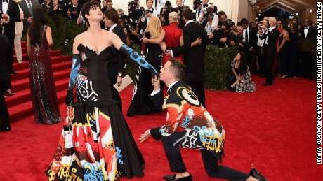Fashion designer Jeremy Scott kisses singer Katy Perry's hand at the Met Gala in New York back in May.